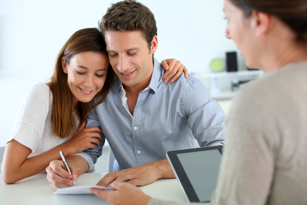 Couple signing real-estate contract