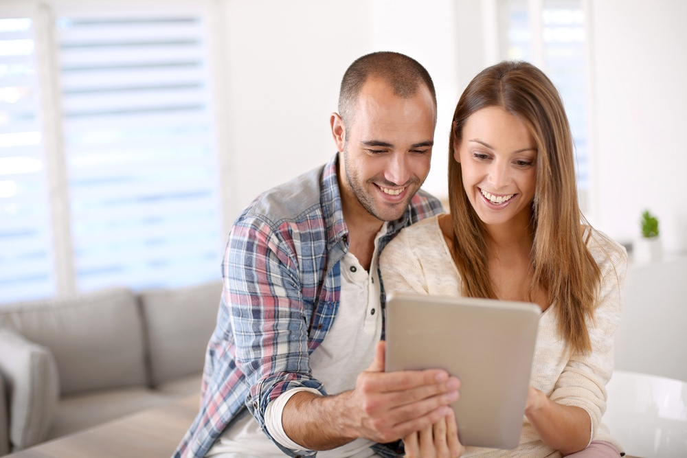 Young couple at home websurfing on internet